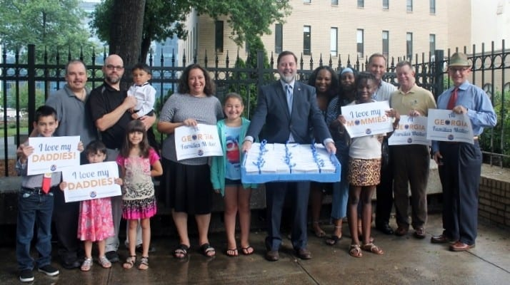Georgia Equality and supporter delivered more than 3,000 petitions to Attorney General Sam Olens in July urging him to drop the defense of the state's same-sex marriage ban. (Photo by Patrick Saunders)