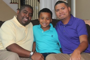 Shelton Stroman and Christopher Inniss with their son, Jonathan. (file photo)