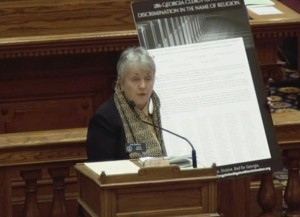 State Sen. Nan Orrock holds up a letter signed by hundreds of faith leaders against bills like the First Amendment Defense Act. (Screenshot)
